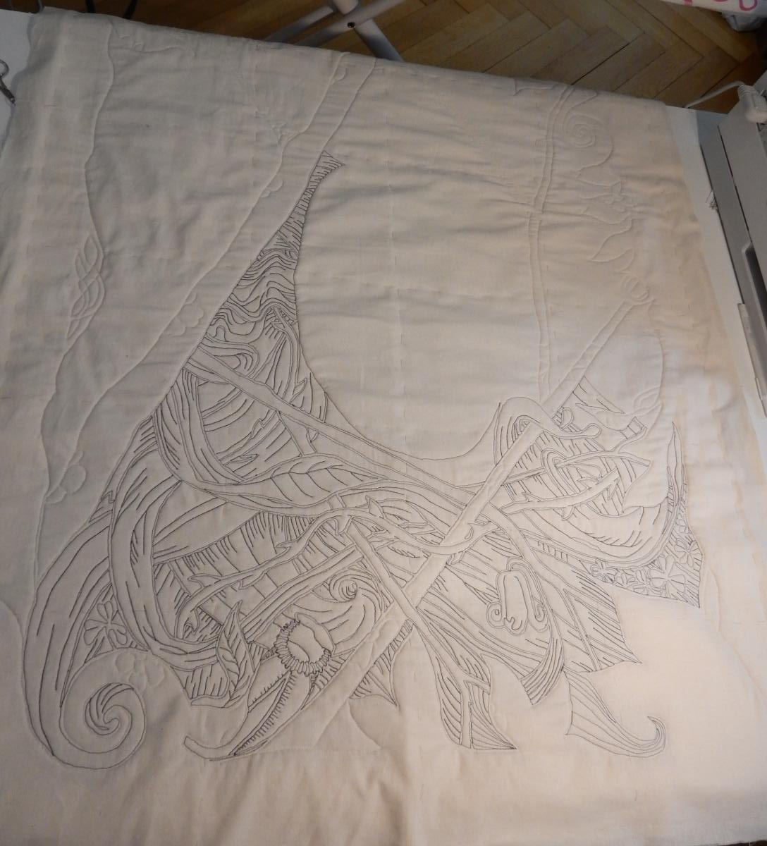 """View of backside of """"Green Woman"""", with quilting partially done."""