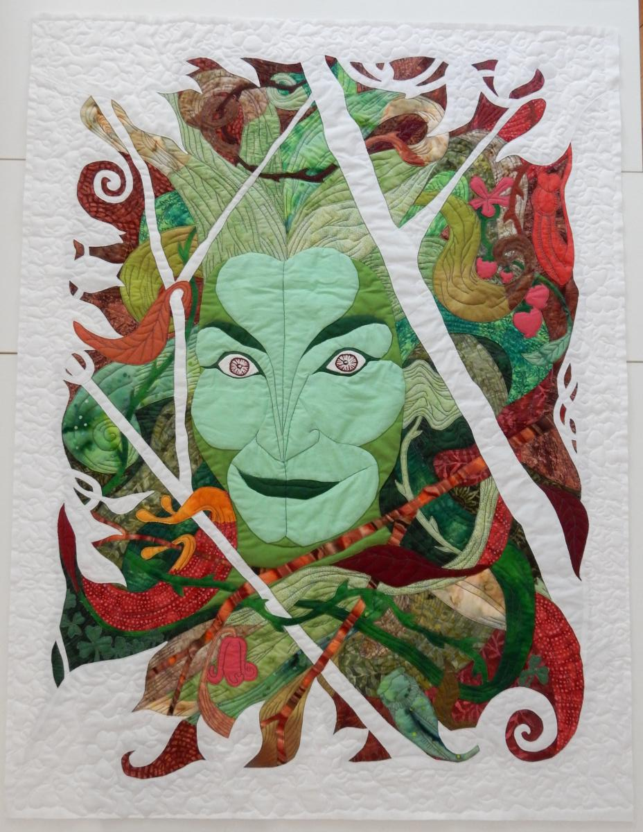 "Overall view of ""Green Woman"" with finished quilting."
