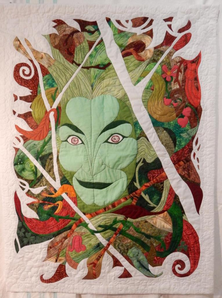 "Finished quilt with image of ""Green Woman"" by Iain Clark."