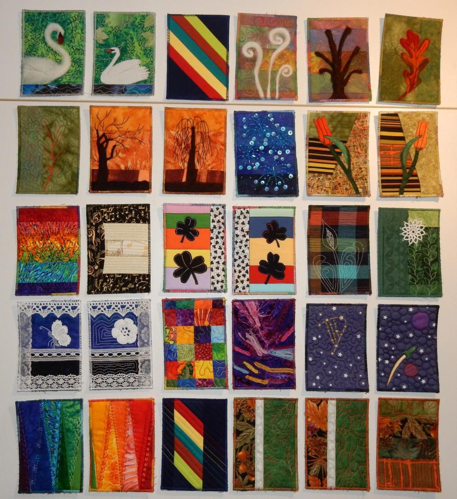 Thirty textile postcards laid out in a 6*5 grid
