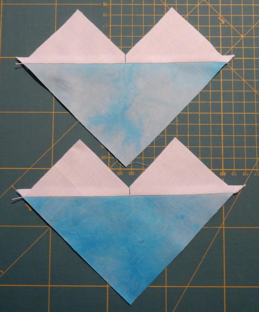 Two units with half a blue square on the bottom and two smaller white half squares sticking out on top.